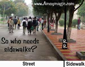 Darwinian Pedestrial tactics; walk on road, not sidewalk, to keep drivers in their place.  Amoy Magic--Guide to Xiamen and Fujian.  http://www.amoymagic.com