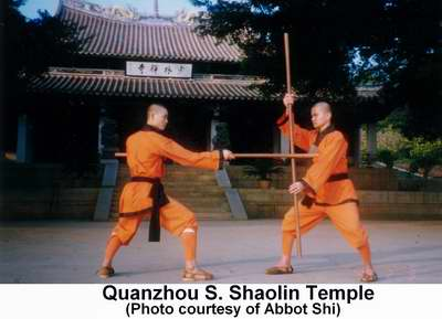 Two S. Shaolin monks battling with poles in front of Quanzhou's Southern Shaolin Temple.  Photo courtesy of Abbot Shi Changding