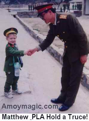 Matthew in PLA uniform making friends with a soldier