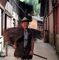 Bill Brown wearing handwoven palm fiber raincape and hat