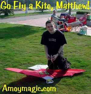 Matthew prepares to fly a kite on the island ring road