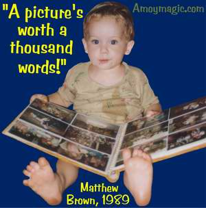 Photograph of Matthew Brown , in Xiamen, two years old, looking at photographs