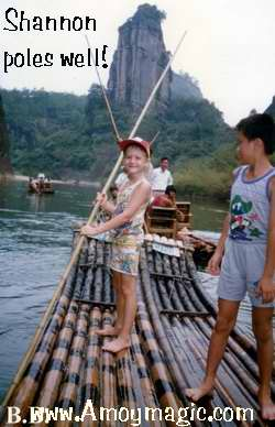 Shannon poles a bamboo raft